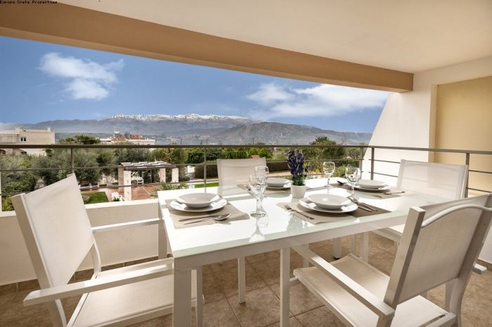 Apartments in a complex with view towards the White Mountains and Souda Bay